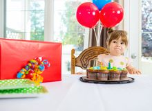 Birthday Girl With Cake And Present On Table Stock Photo