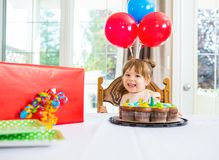 Birthday Girl With Cake And Present On Table Royalty Free Stock Image