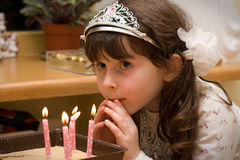 Birthday - girl with candle lights Royalty Free Stock Photo