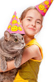 Birthday girl and cat. On hands stock photos