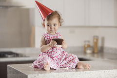 Birthday girl eating cake Royalty Free Stock Image