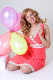 Birthday girl with gift, balloons and lollipop Royalty Free Stock Photos