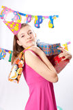 Birthday girl and gifts Stock Image