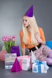 Birthday girl with gifts and flowers Royalty Free Stock Photography
