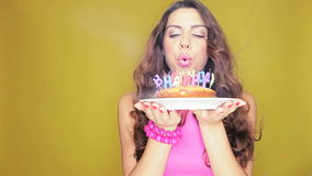 Birthday girl with her cake stock footage