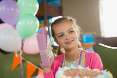 Birthday girl holding a gift box. At home Stock Photo