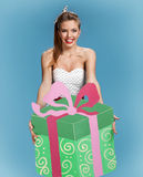 Birthday girl with large green gift box Royalty Free Stock Image
