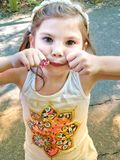 Birthday girl at the park. stock photography