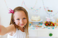 Birthday girl at party Stock Photo