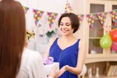 Birthday girl receiving presents Stock Photo