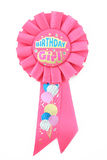 Birthday Girl Ribbon. Pink ribbon for the birthday girl on a white background stock photo