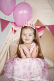 Birthday girl wearing a pink dress and crown royalty free stock images