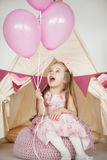 Birthday girl wearing a pink dress and crown royalty free stock photo