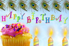 Birthday greeting card with cupcake and candle in sky background Royalty Free Stock Image