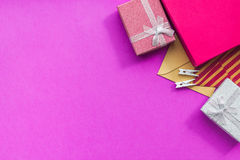 Birthday greeting cards and wrapped gifts on fuchsia background top view copyspace Royalty Free Stock Image