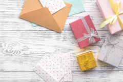 Birthday greeting cards and wrapped gifts on grey wooden desk top view copyspace.  Stock Photography