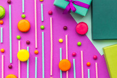 Birthday greeting cards, wrapped gifts and sweets on fuchsia background top view Royalty Free Stock Photos