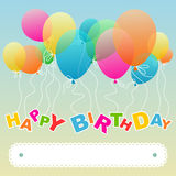 Birthday greeting with floating balloons. Festive birthday greeting card with colorful balloons floating and copyspace for your text Royalty Free Stock Photo