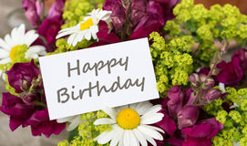 Birthday greetings. Birthday card with snapdragons and daisies stock image