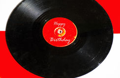 Birthday greetings on a colored background. And old vinyl records stock photo