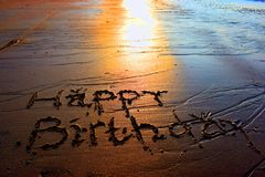 Birthday Greetings On The Sand. When sunset stock photo