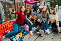 Selfie rooftop friends share youth bff lifestyle stock images