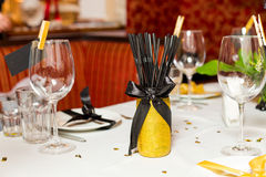 Birthday guests table setting with fresh flowers in black and gold style, indoor Stock Images