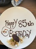Birthday. 85 happy birthday desert plate chocolates royalty free stock photo
