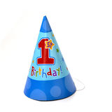 Birthday hat 0027. A birthday cone shaped hat that signifies a first boy's birthday, because of it's dominant blue that majorly reflects a boy's color Royalty Free Stock Photo