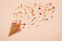 Birthday hat with confetti on paper background Royalty Free Stock Images