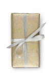 Birthday holiday gift box in golden paper isolated on white Stock Photos