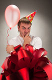 Birthday man looking big gift box Stock Image