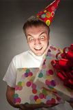 Birthday man opening gift box Royalty Free Stock Photos