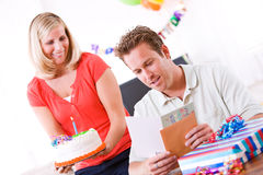 Birthday: Man Reads Card Before Getting Cake Royalty Free Stock Photos