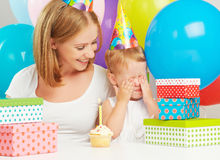 Birthday. mom, baby daughter, balloons, cake, gifts Stock Images