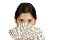 Birthday Money. Hispanic teen holding over $1,000 in front of her face Stock Images
