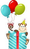 Birthday monkey on gift box Stock Photo