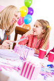 Birthday: Mother Cutting Birthday Cake For Girl Royalty Free Stock Photos