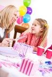 Birthday: Mother Cutting Birthday Cake For Girl Royalty Free Stock Photos