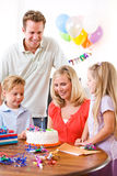 Birthday: Mother Making A Wish Before Blowing Out Candle Stock Images