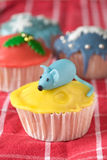 Birthday mouse. Little cupcake decorated with a mouse in marzipan royalty free stock photo