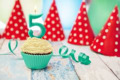 Birthday muffin with a single candle. And blue ribbon Stock Photo