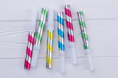 Birthday noisemaker toys on wooden background. Set of colorful Birthday whistles. Accessories for Birthday party stock photography