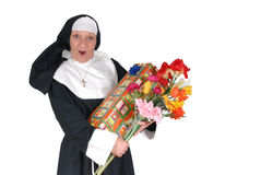 Birthday nun, sister. Middle aged sister, nun with birthday present and flowers. Religion, christianity, lifestyle, holiday concept royalty free stock photo