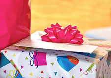 Birthday Package With Pink Bow. A birthday present with card and big pink bow stock photo