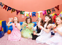 Birthday party. Preschool kids with soap bubbles at the birthday party Royalty Free Stock Image