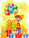 Birthday party. Happy boy with a lot of gifts and balloons Stock Photos