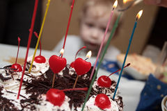 Birthday party. The chocolate cake with candles on a birthday Royalty Free Stock Photos