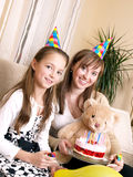 Birthday party. Mother with daughter and birthday cake Royalty Free Stock Images