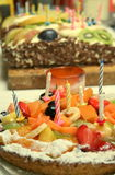 Birthday party. Having some cakes at a birthday party royalty free stock photography